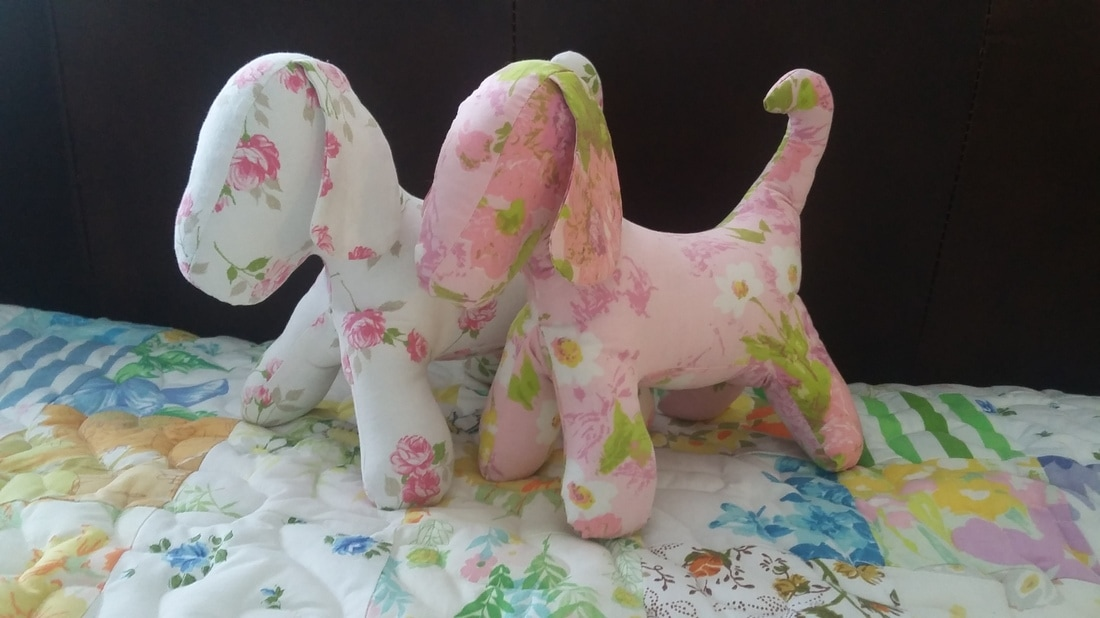 Pink Puppies.  Love the vintage sheets